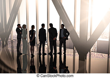 Composite image of business colleagues standing in large...