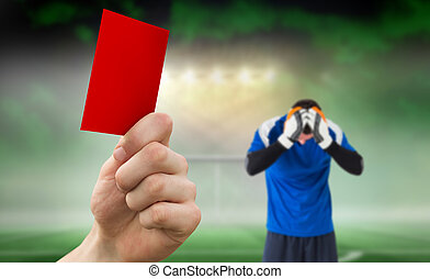Composite image of hand holding up red card - Hand holding...