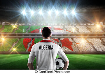 Composite image of algeria football player holding ball -...