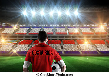 Composite image of costa rica football player holding ball -...