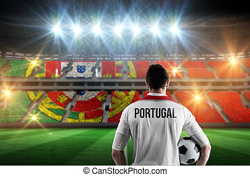 Composite image of portugal football player holding ball -...