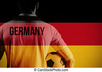 Composite image of germany football player holding ball -...