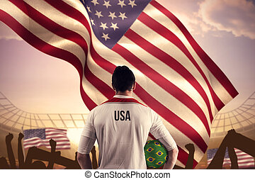 Composite image of usa football player holding ball - Usa...