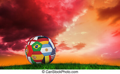 Composite image of football in multi national colours -...