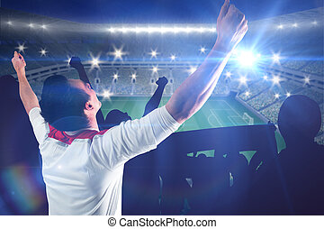 Composite image of excited football fan cheering - Excited...
