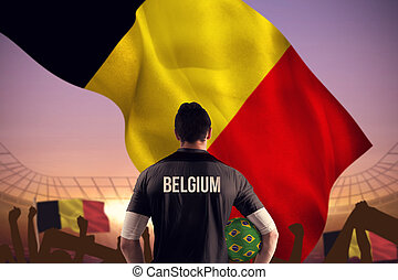Composite image of belgium football player holding ball -...
