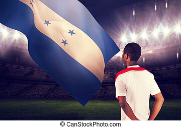 Composite image of football fan in white standing - Football...