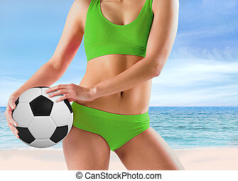 Composite image of fit girl in green bikini holding football...