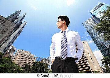 business man looking away to sky