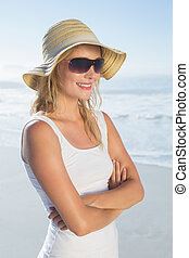 Gorgeous happy blonde posing at the beach on a sunny day