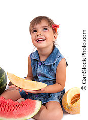 Little  girl eating a watermelon