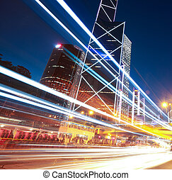 Road light trails on streetscape buildings in HongKong -...