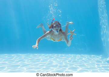 Cute blonde underwater in the swimming pool with snorkel and...