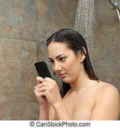 Teenager in the shower obsessed with the smart phone -...