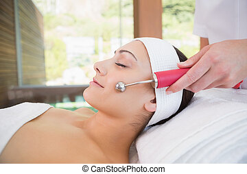 Peaceful brunette getting micro dermabrasion in the health...