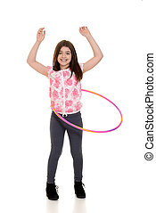 child playing with hula hoop with white background