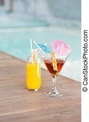 Two cocktails beside the swimming pool