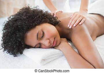 Gorgeous woman enjoying a shoulder massage