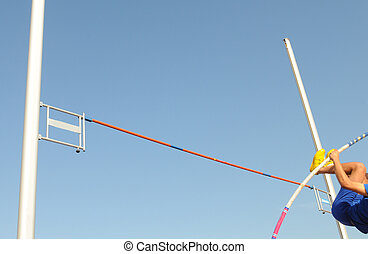 Athlete in the middle of the vaulting phase - Pole vaulting....