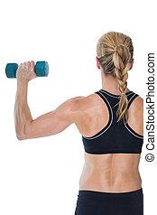 Female bodybuilder holding a blue dumbbell on white...