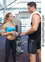 Bodybuilding man and woman talking together