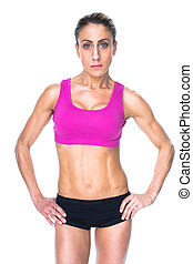 Female bodybuilder posing with hands on hips looking at...