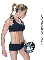 Female blonde bodybuilder holding large black dumbbell on...
