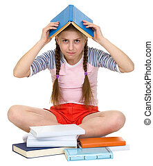 Young girl with book on head on the white