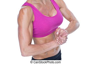 Female bodybuilder flexing mid section on white background