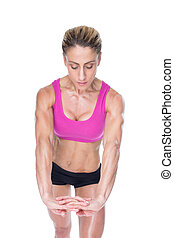 Female bodybuilder flexing with hands together on white...