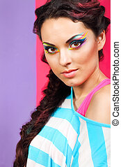 Portrait of a beautiful model with creative make up -...
