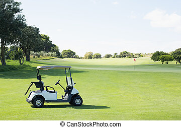 Golf buggy with no one around on a sunny day at the golf...