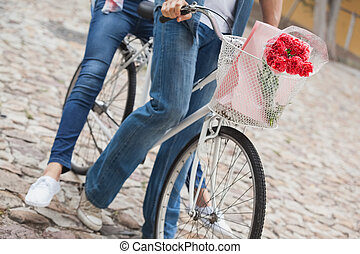 Hip young couple going for a bike r