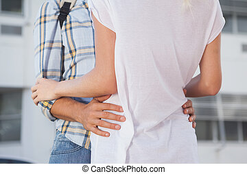 Stylish young couple hugging each other on a sunny day in...