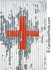 Red cross on the white metal background.