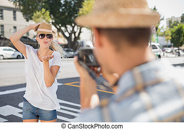 Young pretty blonde posing for her boyfriend on a sunny day...