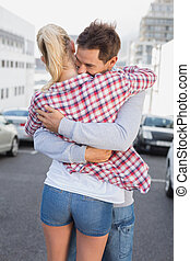 Hip young couple hugging each other on a sunny day in the...
