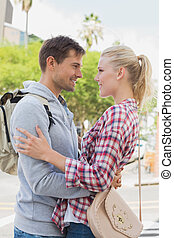Young tourist couple hugging each other on a sunny day in...