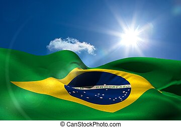 Brazil national flag under sunny sky - Digitally generated...