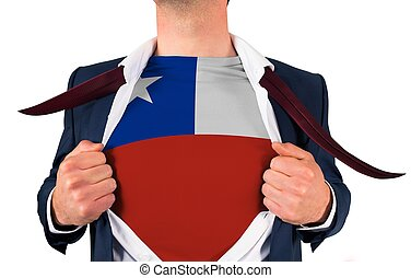 Businessman opening shirt to reveal chile flag on white...
