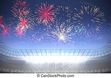 Fireworks exploding over football stadium - Digitally...