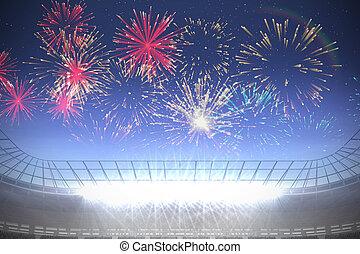 Fireworks exploding over football stadium - Digitally...