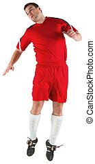 Football player in red jumping