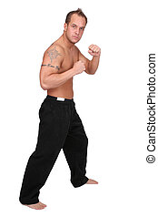 kickboxer man - one adult topless kickboxing man working out...