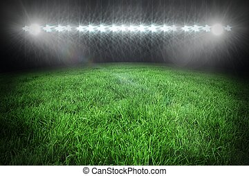 Football pitch under spotlights - Digitally generated...