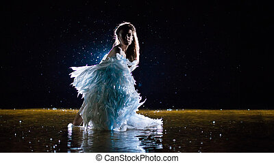 Beautiful white angel is standing in the water