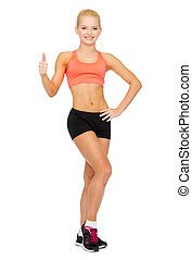 beautiful athletic woman showing thumbs up - fitness, sport...