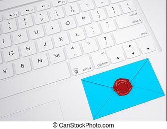 Envelope with stamp on the keyboard