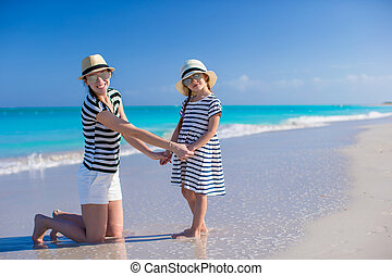 Young mother and little girl enjoy vacation on caribbean...