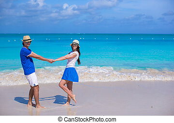 Young happy couple have fun on beach vacation